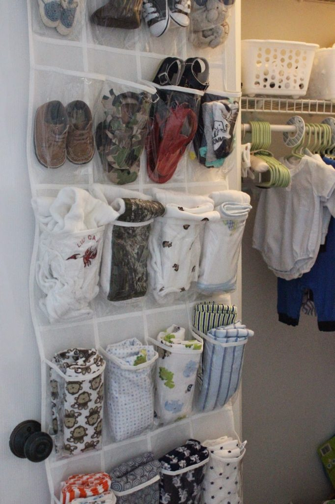 Over the door shoe organizer used to organize baby items.