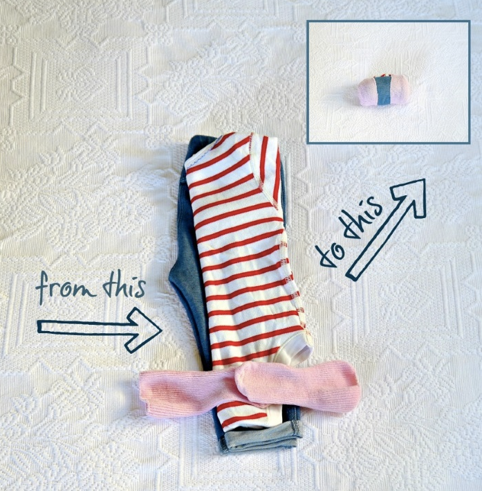 Demonstration of how to roll baby outfit into sock to save space in diaper bag.