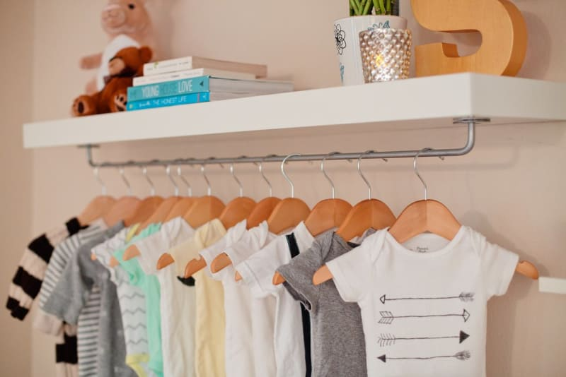 Extra closet space made from floating shelf and attached bygel rail.