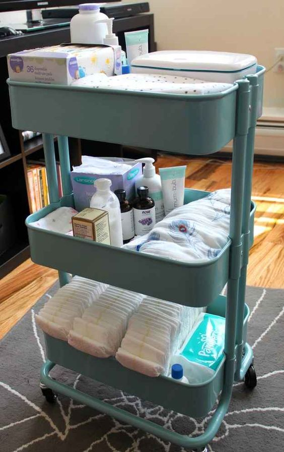 Utility cart filled with baby care items and diapers.