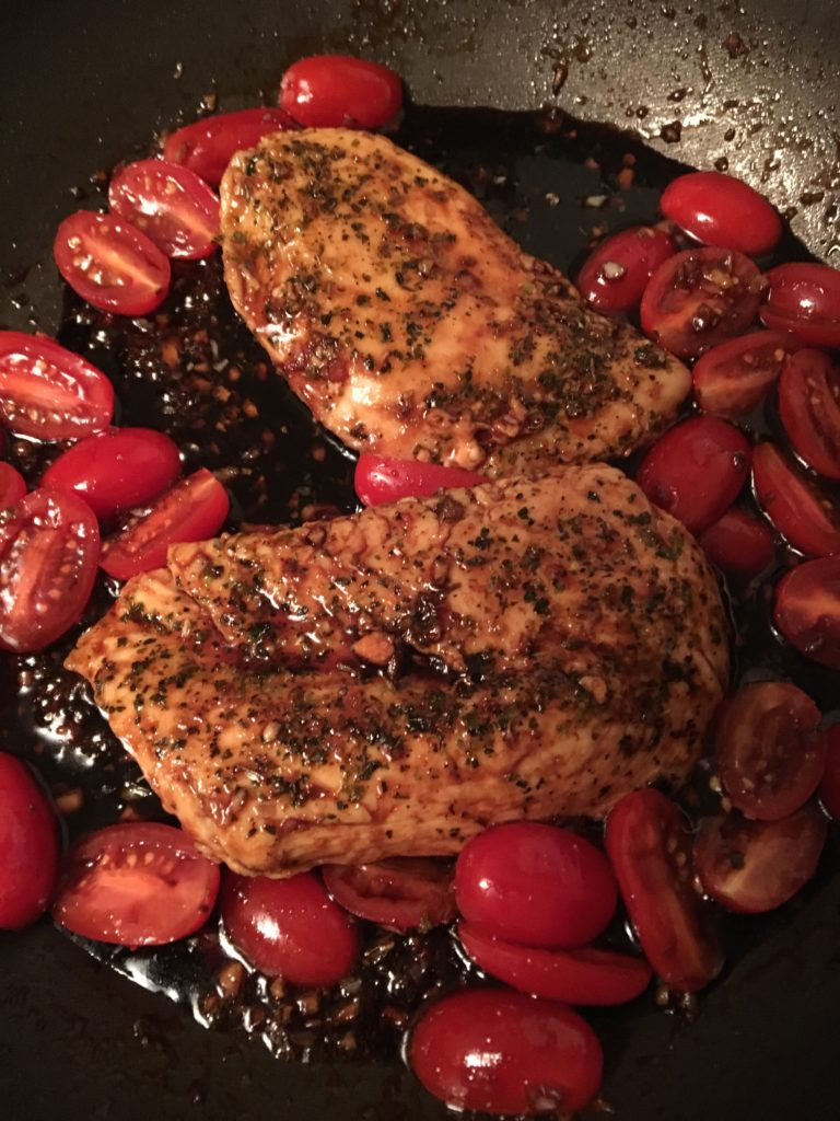 Chicken with balsamic marinade and tomatoes.