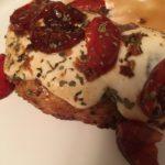 Balsamic Caprese chicken on plate.