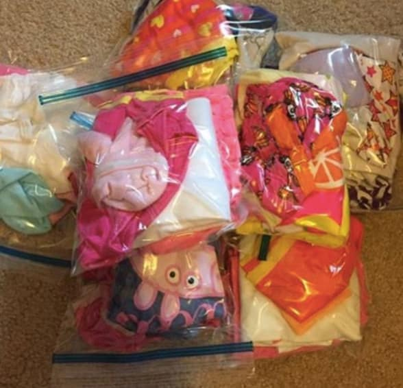 Baby outfits packed into separate Ziploc bags.