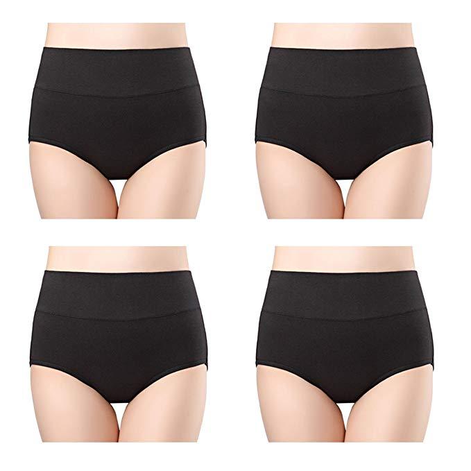 Woman models black undergarments.