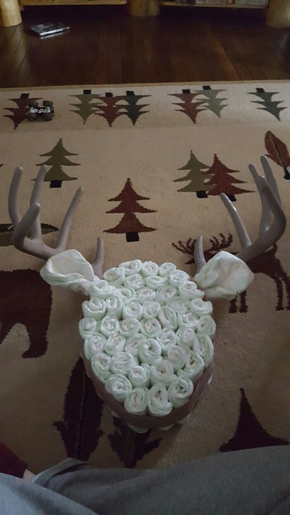 Diapers formed into deer with antlers.