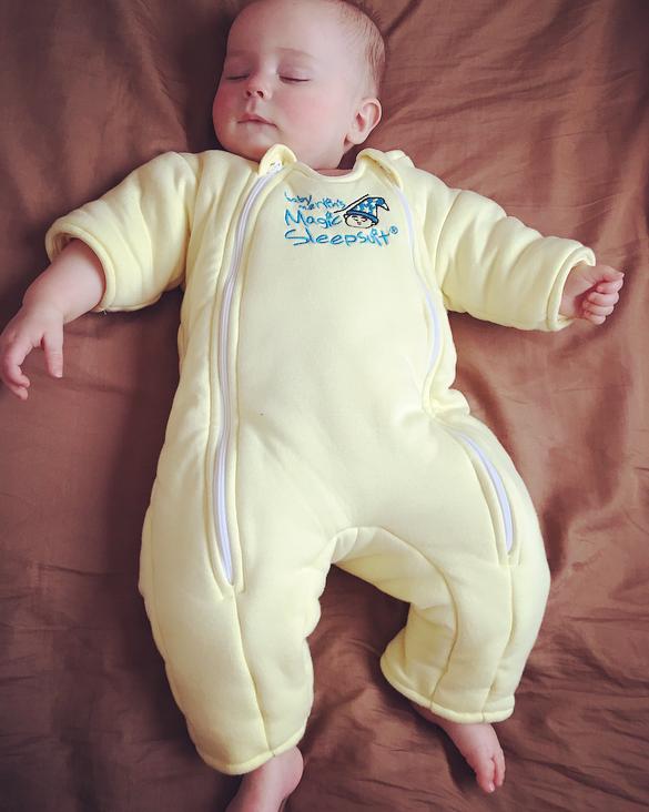 Baby sleeping in yellow suit for sleeping.