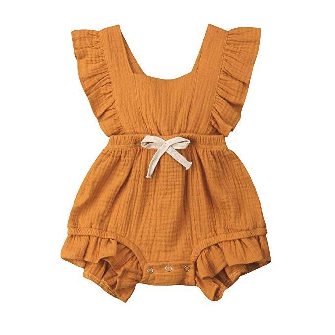 Burnt orange baby girl romper.
