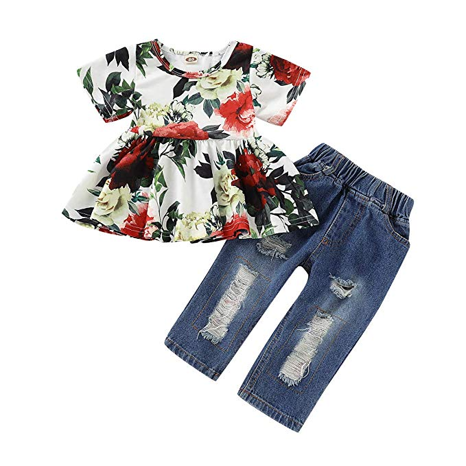 Baby girl peplum top with floral print and matching destressed denim jeans.
