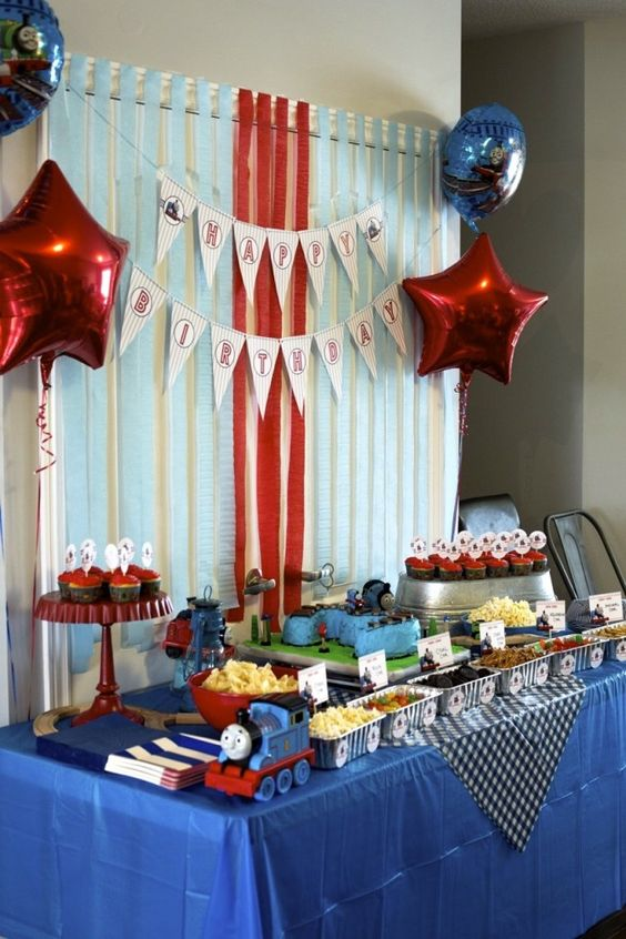 Train decorations and balloons for shower food table.