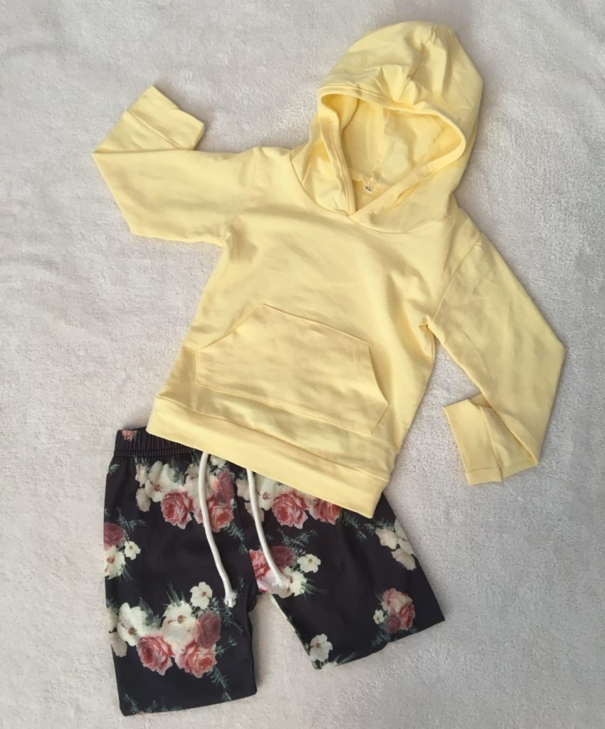 Floral print shorts with matching yellow hoodie for baby girl.
