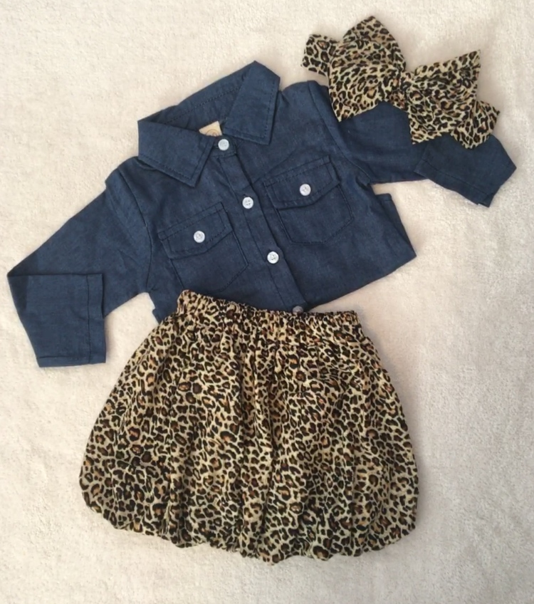 Skirt and matching bow in leopard print with denim long sleeved shirt.