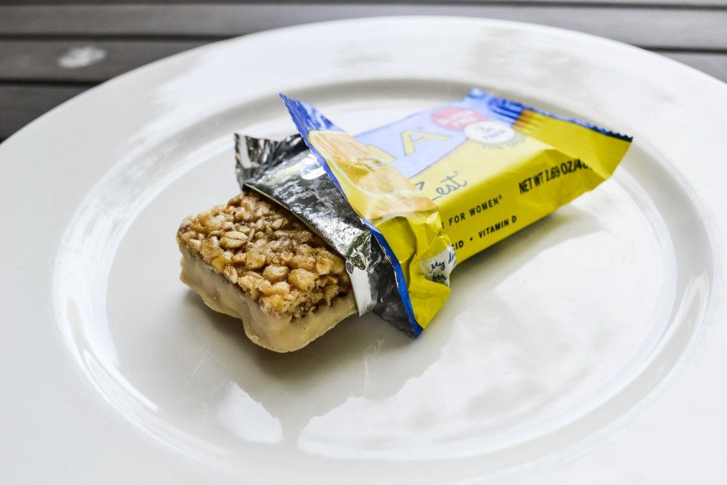 Partially opened LUNA Bar on white plate.