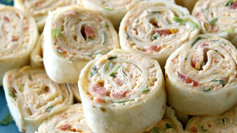 Health pinwheels with deli meat, cheese, hummus and veggies.