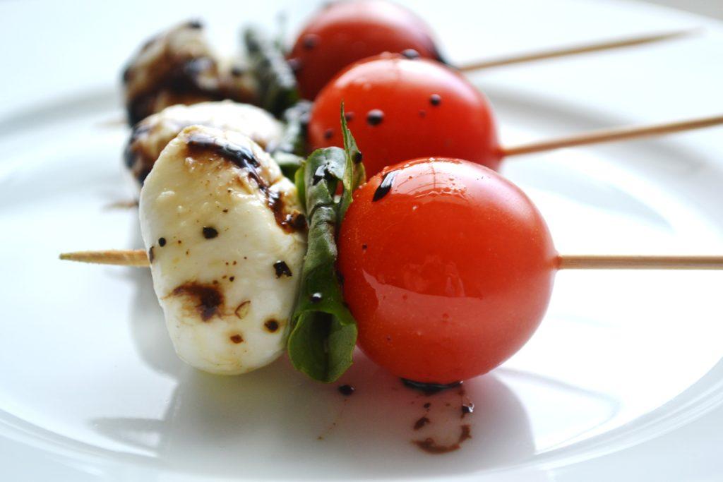 Caprese salad kabobs with tomato, basil and mozzarella cheese.