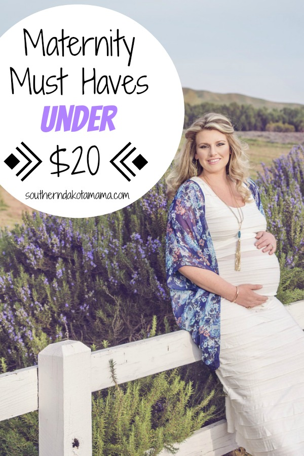 Pinterest graphic with text for Maternity Must Haves and pregnant woman sitting on fence next to lavender field.