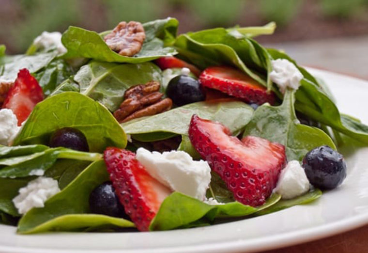 Spinach, strawberry salad with pecans.