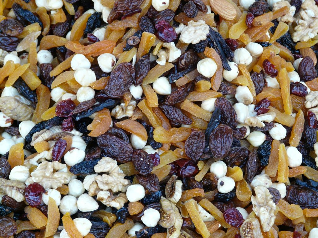 Trail mix snack with raisons, dried fruit and nuts.
