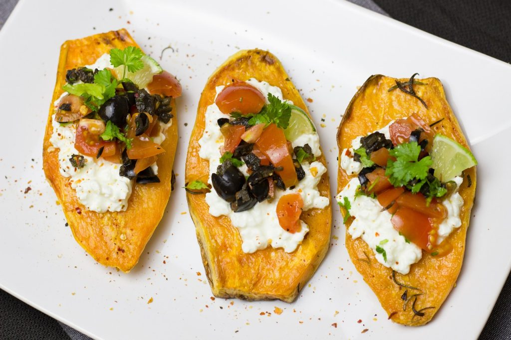 Sweet potato with goat cheese and toppings.