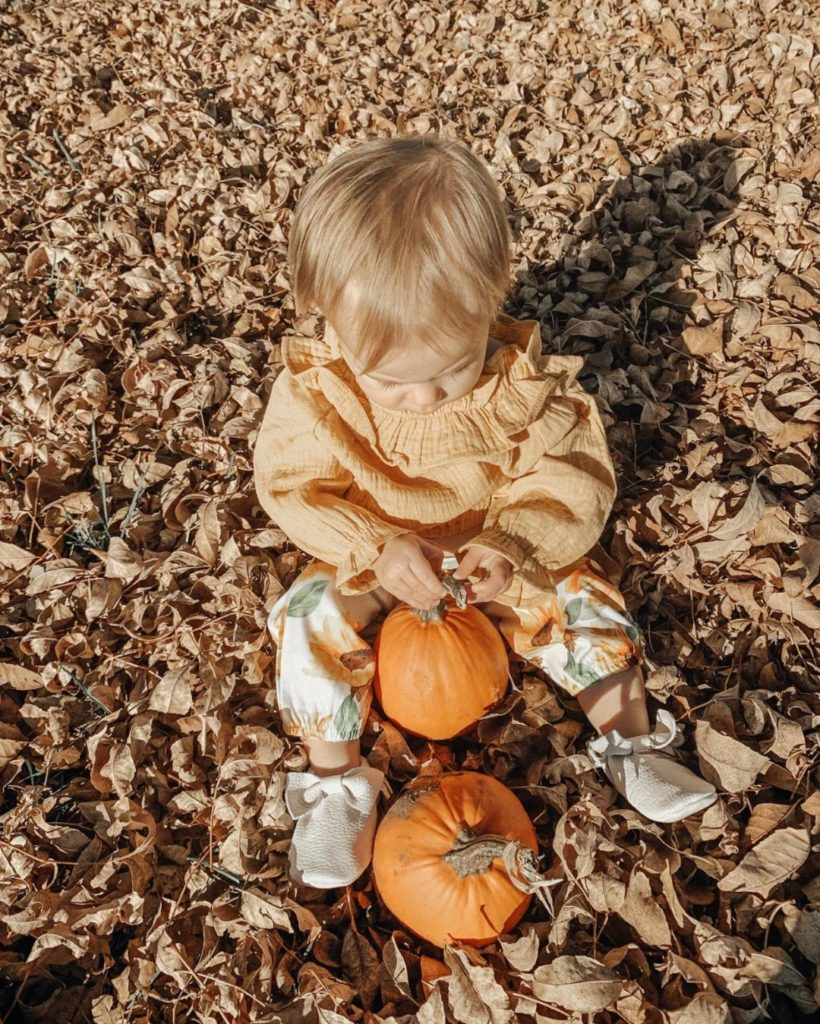 Girl wears orange outfit for fall.