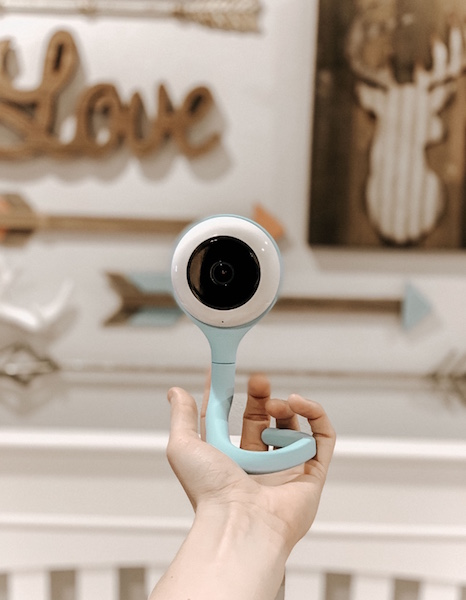 Woman holds Lollipop Baby Camera in nursery.