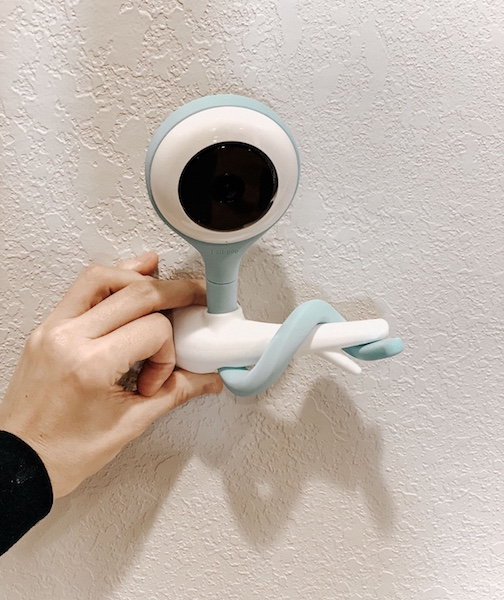 Woman installs Lollipop baby monitor to wall.