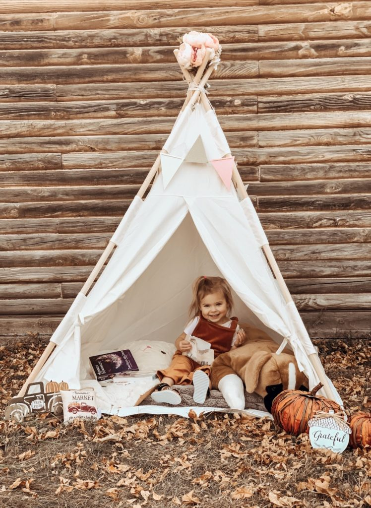 Toddler girl plays in Children's Teepee.