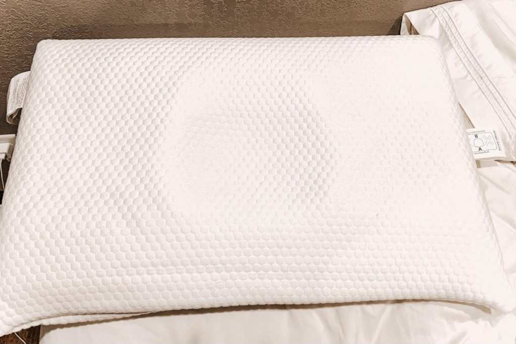 Tri-Core Ultimate Cervical Pillow on bed.